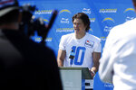Los Angeles Chargers quarterback Justin Herbert talks during a news conference after practice at the NFL football team's training camp in Costa Mesa, Calif., Wednesday, July 28, 2021. (AP Photo/Alex Gallardo)