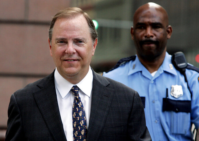 FILE - In this Monday, April 17, 2006 file photo, former Enron executive Jeffrey Skilling is escorted to the federal courthouse for his first day of cross examination in his fraud and conspiracy trial in Houston. ormer Enron Corp. CEO Jeffrey Skilling has been released from federal custody, Thursday, Feb. 21, 2019. His discharge comes after serving 12 years in prison and six months in a halfway house for his actions that led to one of the worst corporate meltdowns in history. (AP Photo/Pat Sullivan, File)