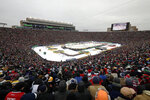 FILE - In this Jan. 1, 2019, file photo, the Boston Bruins and the Chicago Blackhawks play in the NHL Winter Classic hockey game at Notre Dame Stadium in South Bend, Ind. Outdoor games have become the the marquee event of the NHL season ever since the league staged the first Winter Classic in Buffalo in 2008. None of the 30 previous outdoor games had quite a setup like this season when the league will stage two games this weekend on the 18th fairway of a golf course on the shores of Lake Tahoe, with the Sierra Nevada Mountains towering in the background.  (AP Photo/Nam Y. Huh, File)