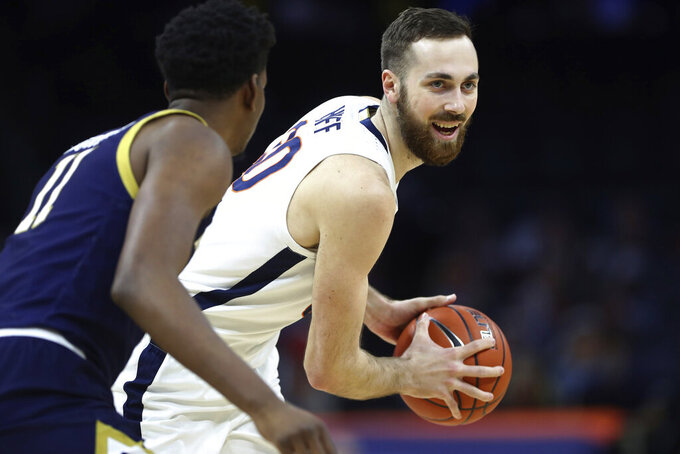 Virginia forward Jay Huff (30) looks to pass the ball during an NCAA college basketball game against Notre Dame, Wednesday, Jan. 13, 2021, in Charlottesville, Va. (Erin Edgerton/The Daily Progress via AP, Pool)
