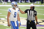 Detroit Lions quarterback Matthew Stafford (9) is helped off the field after getting injured during the second half of an NFL football game against the Minnesota Vikings, Sunday, Nov. 8, 2020, in Minneapolis. (AP Photo/Bruce Kluckhohn)
