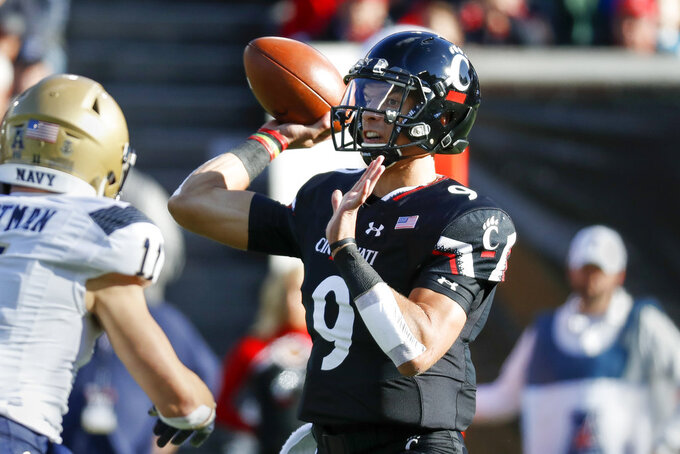 Cincinnati quarterback Desmond Ridder (9) passes in the first half of an NCAA college football game against Navy, Saturday, Nov. 3, 2018, in Cincinnati. (AP Photo/John Minchillo)