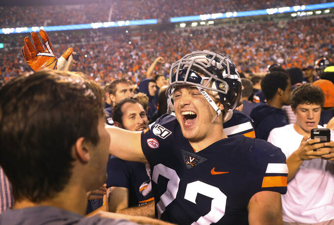 Virginia linebacker Rob Snyder (22) celebrates with fans after Virginia defeated Florida State 31-24 during an NCAA college football game in Charlottesville, Va., Saturday, Sept. 14, 2019. (AP Photo/Andrew Shurtleff)