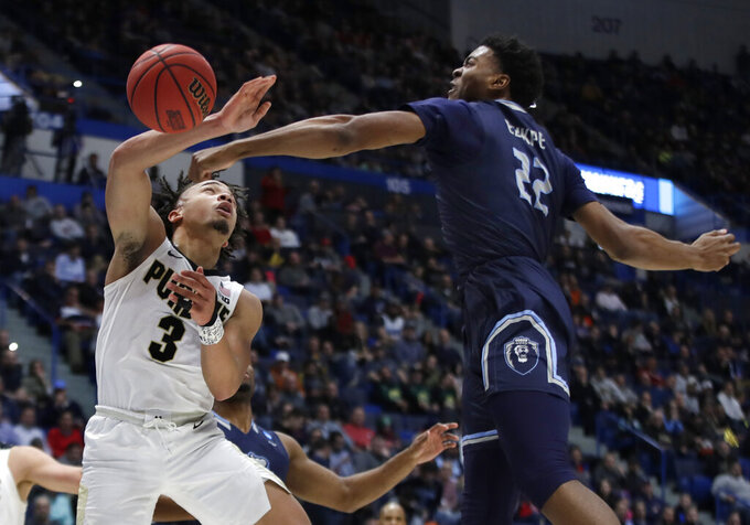 Old Dominion's Kalu Ezikpe (22) blocks a shot by Purdue's Carsen Edwards (3) during the first half of a first round men's college basketball game in the NCAA Tournament, Thursday, March 21, 2019, in Hartford, Conn. (AP Photo/Elise Amendola)