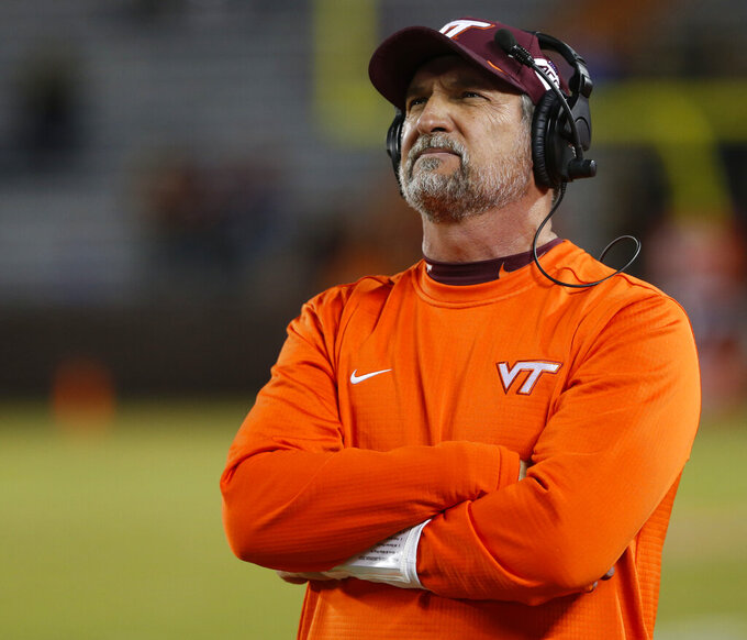 FILE - In this Oct. 25, 2018, file photo, Virginia Tech defensive coordinator Bud Foster looks at the scoreboard during the second half of an NCAA college football game against Georgia Tech, in Blacksburg, Va. Foster says the upcoming football season will be his final as an assistant coach. Foster has been the Hokies' defensive coordinator since 1995. His 33 years on staff makes him the longest tenured assistant coach in the country at the same school. (AP Photo/Steve Helber, File)