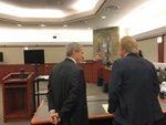 Las Vegas Sands Corp. attorneys Richard Sauber, left, and James Jimmerson, right, confer Thursday, March 14, 2019, in a Las Vegas courtroom before announcing a mid-trial settlement of a 15-year breach-of-contract battle Hong Kong businessman Richard Suen. Attorneys said the agreement prohibited them from disclosing financial terms. Suen helped Las Vegas Sands open its first casino in the Chinese gambling enclave of Macau in 2004. (AP Photo/Ken Ritter)