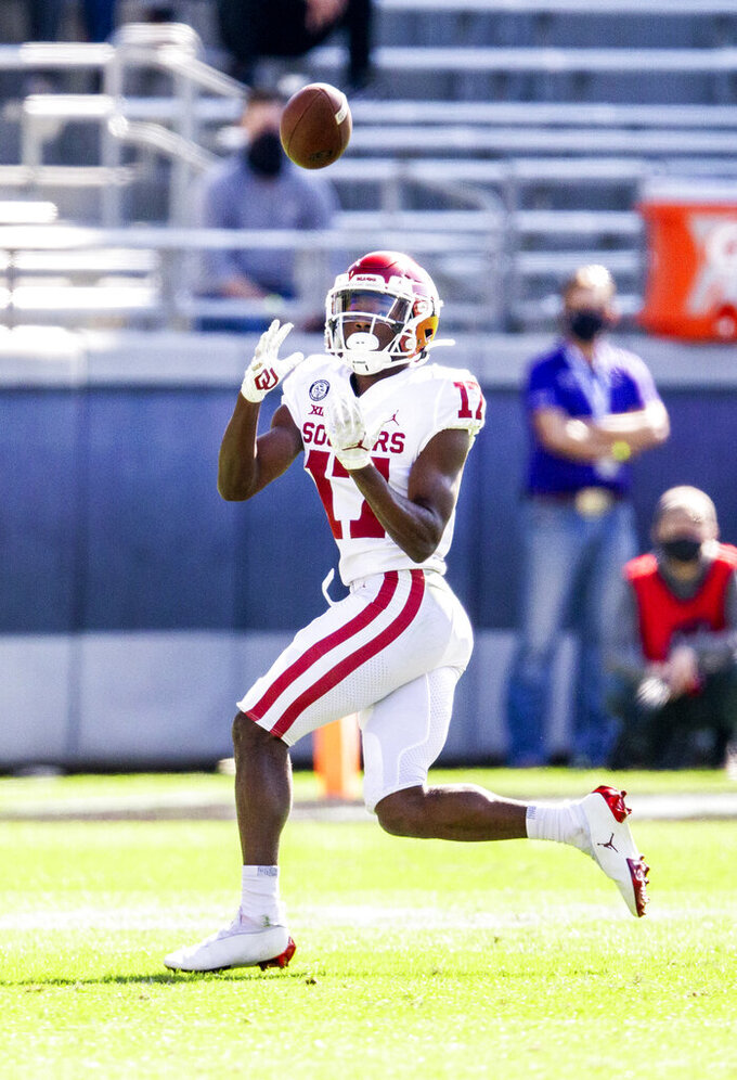 Oklahoma wide receiver Marvin Mims (17) catches a pass during the first half of an NCAA College football game against TCU, Saturday, Oct. 24, 2020, in Fort Worth, Texas. Mims would run the pass in for a touchdown on the play. (AP Photo/Brandon Wade)