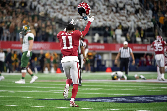 Oklahoma cornerback Parnell Motley (11) tosses his helmet in celebration after Baylor's pass fell incomplete on the final play of the game in overtime of an NCAA college football game for the Big 12 Conference championship, Saturday, Dec. 7, 2019, in Arlington, Texas. Oklahoma won 30-23. (AP Photo/Jeffrey McWhorter)