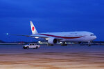 The plane with Japanese Prime Minister Yoshihide Suga aboard, arrives at Andrews Air Force Base, Md., Thursday, April 15, 2021. Suga will be the first foreign leader to have a face-to-face meeting with President Joe Biden, when they meet at the White House on Friday. (AP Photo/Manuel Balce Ceneta)