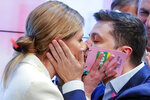 Ukrainian comedian and presidential candidate Volodymyr Zelenskiy, and his wife Olena Zelenska, left, kiss each other after the second round of presidential elections in Kiev, Ukraine, Sunday, April 21, 2019. Ukrainians voted on Sunday in a presidential runoff as the nation's incumbent leader struggles to fend off a strong challenge by a comedian who denounces corruption and plays the role of president in a TV sitcom. (AP Photo/Vadim Ghirda)