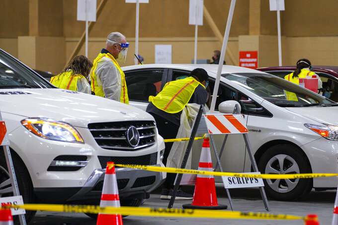 Vaccines are distributed to patients at the new drive-thru site at the Del Mar Fairgrounds on Friday, Feb. 12, 2021 in Del Mar, Calif. (Nelvin C. Cepeda/The San Diego Union-Tribune via AP, Pool)