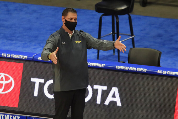 Morehead State coach Preston Spradlin gesture during the first half of the team's NCAA college basketball game against Kentucky in Lexington, Ky., Wednesday, Nov. 25, 2020. (AP Photo/James Crisp)