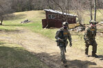 Members of the Vermont State Police tactical team search outbuildings for 51-year-old Harley Breer, who allegedly assaulted a neighbor in Marshfield last week, in Marshfield, Vt., Sunday, April 11, 2021. Breer has a criminal history including convictions for kidnapping and aggravated domestic assault, authorities said. (AP Photo/Lisa Rathke)