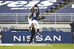 Penn State wide receiver Jahan Dotson (5) catches a second-quarter touchdown pass in front of Maryland defensive back Jakorian Bennett (2) during an NCAA college football game in State College, Pa., Saturday, Nov. 7, 2020. (AP Photo/Barry Reeger)