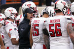 Texas Tech head coach Matt Wells talks with his players during a time out in the second half of an NCAA college football game against Oklahoma State in Stillwater, Okla., Saturday, Nov. 28, 2020. (AP Photo/Sue Ogrocki)
