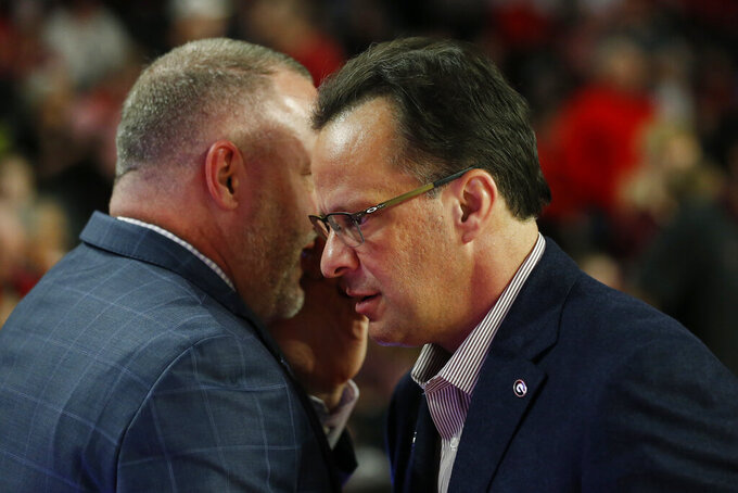 Texas A&M coach Buzz Williams speaks with Georgia coach Tom Crean before an NCAA basketball game in Athens, Ga., on Saturday, Feb. 1, 2020. (Joshua L. Jones/Athens Banner-Herald via AP)