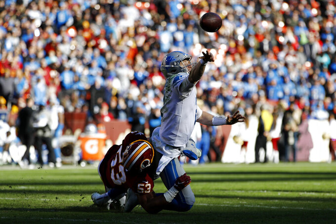 Detroit Lions quarterback Jeff Driskel, top, tries to throw a pass while being hit by Washington Redskins inside linebacker Jon Bostic (53) during the first half of an NFL football game, Sunday, Nov. 24, 2019, in Landover, Md. (AP Photo/Patrick Semansky)