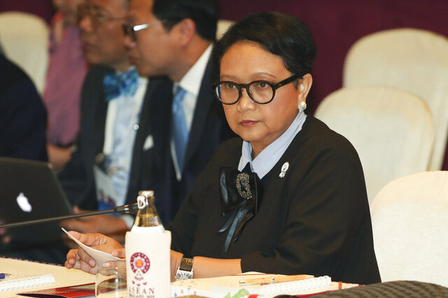 FILE - In this July 31, 2019, file photo, Indonesian Foreign Minister Retno Marsudi sits at the start of ASEAN Foreign Ministers meeting plenary session in Bangkok, Thailand. Foreign Minister Marsudi said in a video conference Sunday, May 10, 2020, from the capital, Jakarta, that 49 Indonesian fishermen, ranging from 19 to 24 years old, were forced to work an average of over 18 hours a day on at least four Chinese fishing boats.  (AP Photo/Sakchai Lalit, File)