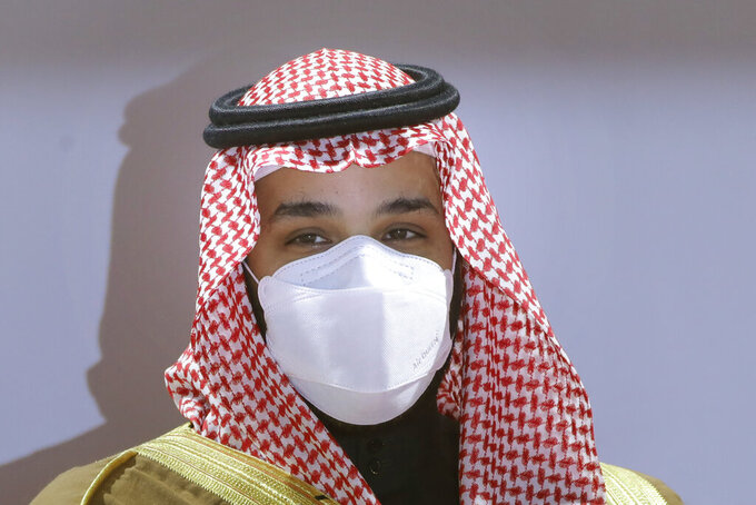 FILE - In this Feb. 20, 2021, file photo, Saudi Crown Prince Mohammed bin Salman wears a face mask to help curb the spread of the coronavirus as he attends the Saudi Cup award ceremony during the final race of the $20 million, the Saudi Cup, at King Abdul Aziz race track in Riyadh, Saudi Arabia. The crown prince laid out a vigorous defense of his domestic policies and the thinking behind his push to transform Saudi Arabia economically and socially during a wide-ranging interview broadcast across Saudi television channels late Tuesday, April 27, 2021.  (AP Photo/Amr Nabil, File)