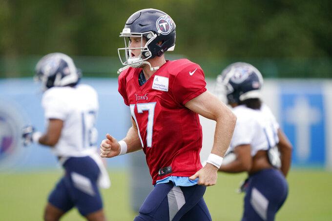 Tennessee Titans quarterback Ryan Tannehill (17) runs to a drill during NFL football training camp Friday, Aug. 28, 2020, in Nashville, Tenn. (AP Photo/Mark Humphrey, Pool)