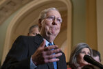 Senate Majority Leader Mitch McConnell, R-Ky., tells reporters he has secured enough Republican votes to start President Donald Trump's impeachment trial and postpone a decision on witnesses and documents Democrats want, at the Capitol in Washington, Tuesday Jan. 7, 2020. (AP Photo/J. Scott Applewhite)