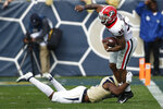 Georgia running back Brian Herrien (35) tires to break a tackle from Georgia Tech defensive back Josh Carlson (10) in the first half of an NCAA football game between Georgia and Georgia Tech on Saturday, Nov. 30, 2019, in Atlanta. (Joshua L. Jones/Athens Banner-Herald via AP)