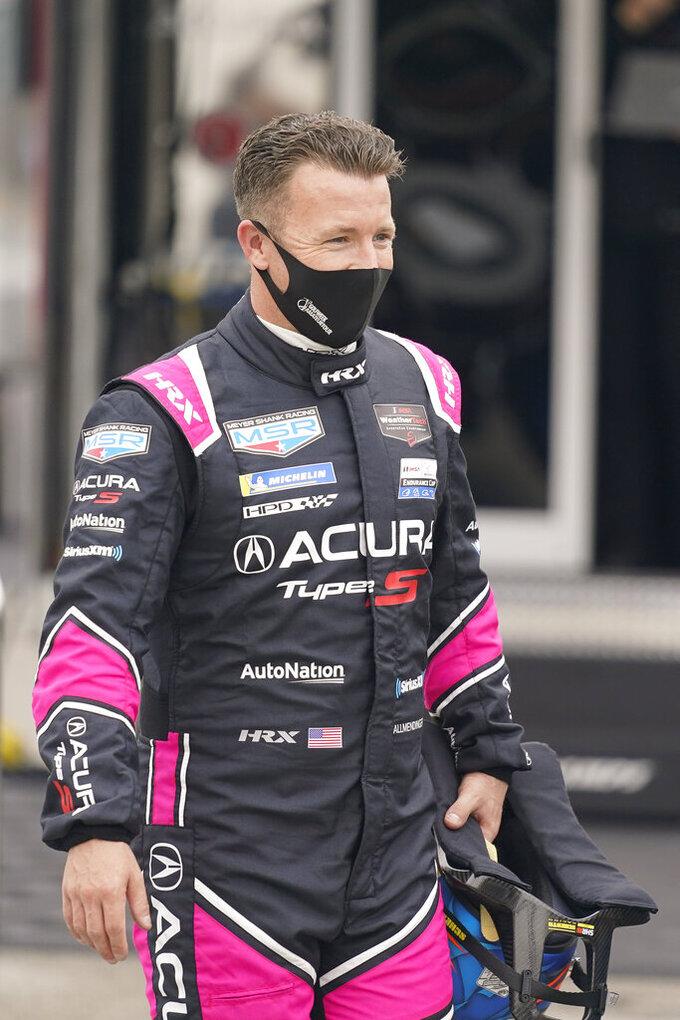AJ Allmendinger walks back to his garage after a practice session for the Rolex 24 hour auto race at Daytona International Speedway, Saturday, Jan. 23, 2021, in Daytona Beach, Fla. (AP Photo/John Raoux)