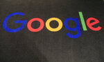 FILE - In this Nov. 18, 2019, file photo, the logo of Google is displayed on a carpet at the entrance hall of Google France in Paris. Google broke Australian law by misleading users about personal location data collected through Android mobile devices, a judge found Friday, April 16, 2021. (AP Photo/Michel Euler, File)