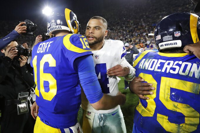 Los Angeles Rams quarterback Jared Goff greets Dallas Cowboys quarterback Dak Prescott after their win during an NFL divisional football playoff game Saturday, Jan. 12, 2019, in Los Angeles. (AP Photo/Marcio Jose Sanchez)