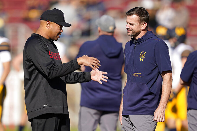 Stanford head coach David Shaw, left, talks with California head coach Justin Wilcox, right, before the first half of an NCAA game Saturday, Nov. 23, 2019 in Stanford, Calif. (AP Photo/Tony Avelar)
