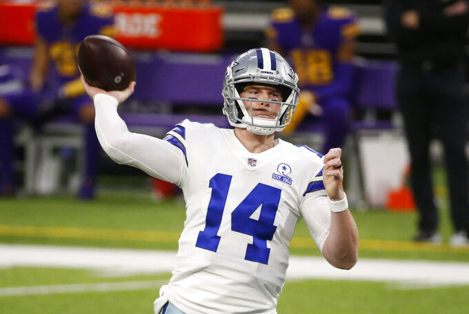 Dallas Cowboys quarterback Andy Dalton throws a pass during the first half of an NFL football game against the Minnesota Vikings, Sunday, Nov. 22, 2020, in Minneapolis. (AP Photo/Bruce Kluckhohn)