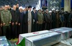 FILE- In this photo released by the official website of the Office of the Iranian Supreme Leader, supreme leader Ayatollah Ali Khamenei, front row, fourth from left, leads a prayer over the coffins of Gen. Qassem Soleimani and his comrades, who were killed in Iraq in a U.S. drone strike on Friday, at the Tehran University campus, in Tehran, Iran, Monday, Jan. 6, 2020. (Office of the Iranian Supreme Leader via AP, File)