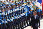 French President Emmanuel Macron reviews the honor guards during a welcome ceremony ahead of a meeting with Serbian President Aleksandar Vucic in Belgrade, Serbia, Monday, July 15, 2019. French President Emmanuel Macron is for a two days official visit in Belgrade. (AP Photo/Darko Vojinovic)