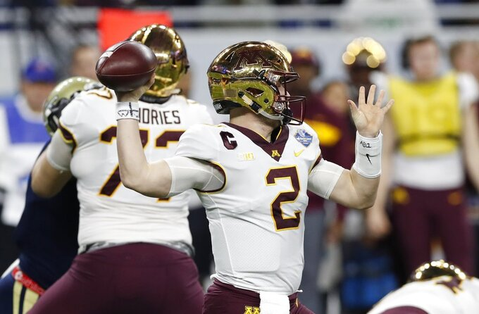 Minnesota quarterback Tanner Morgan (2) throws a pass during the first half of the Quick Lane Bowl NCAA college football game against Georgia Tech, Wednesday, Dec. 26, 2018, in Detroit. (AP Photo/Carlos Osorio)