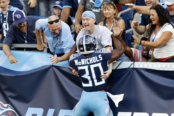 Tennessee Titans running back Jeremy McNichols celebrates after scoring a touchdown against the New England Patriots in the first half of a preseason NFL football game Saturday, Aug. 17, 2019, in Nashville, Tenn. (AP Photo/James Kenney)