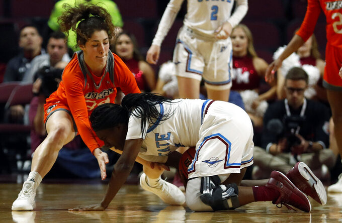 Texas-Rio Grande Valley forward Megan Johnson (34) and New Mexico State guard Stabresa McDaniel (3) fight for a loose ball during a NCAA college basketball Western Athletic Conference Women's Tournament championship game Saturday, March 16, 2019, in Las Vegas. (AP Photo/Steve Marcus)