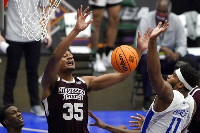 Mississippi State forward Tolu Smith (35) has the ball stripped away on a shot attempt by Saint Louis forward Hasahn French (11) during the second half of an NCAA college basketball game in the first round of the NIT Tournament, Saturday, March 20, 2021, in Frisco, Texas. (AP Photo/Tony Gutierrez)
