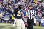 Purdue running back King Doerue (22) celebrates a touchdown against Nebraska during the second half of an NCAA college football game in West Lafayette, Ind., Saturday, Nov. 2, 2019. Purdue defeated Nebraska 31-27. (AP Photo/Michael Conroy)