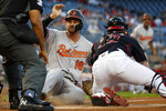 Baltimore Orioles' Trey Mancini (16) is safe at home before the tag by Washington Nationals catcher Yan Gomes during the first inning of a baseball game at Nationals Park Tuesday, Aug. 27, 2019, in Washington. (AP Photo/Alex Brandon)