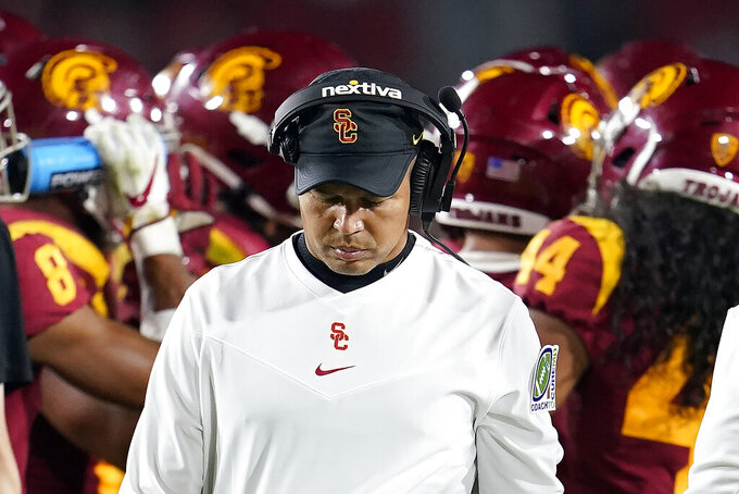 Southern California head coach Donte Williams walks away from the huddle during the second half of an NCAA college football game against Oregon State Saturday, Sept. 25, 2021, in Los Angeles. (AP Photo/Marcio Jose Sanchez)