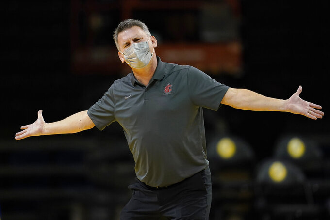Washington State head coach Kyle Smith gestures toward officials during the first half of his team's NCAA college basketball game against Stanford in Santa Cruz, Calif., Saturday, Jan. 9, 2021. (AP Photo/Jeff Chiu)