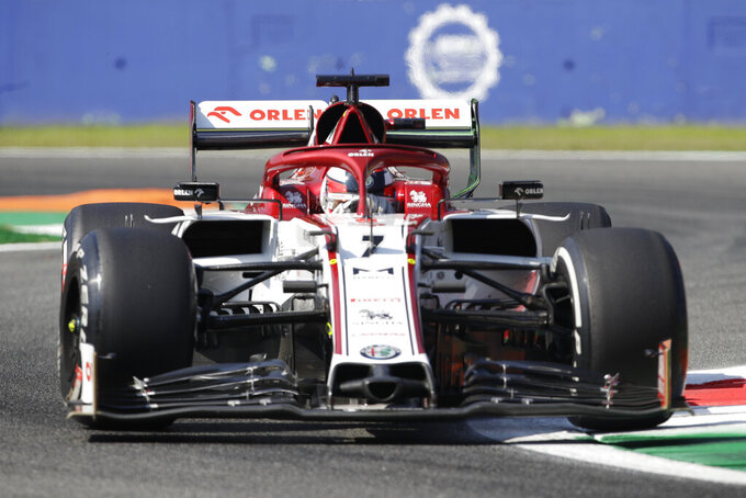 FILE - In this file photo dated Friday, Sept. 4 , 2020, Alfa Romeo driver Kimi Raikkonen of Finland steers his car during the first practice session for the Italian Formula One Grand Prix, at the Monza racetrack in Monza, Italy. Kimi Raikkonen and Antonio Giovinazzi will remain with Alfa Romeo next season, the Italian car brand announced Friday Oct. 30, 2020. (AP Photo/Luca Bruno, FILE)