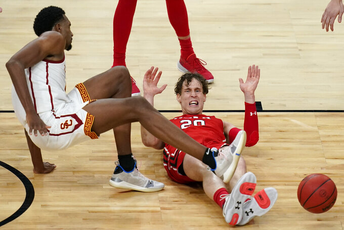 Utah's Mikael Jantunen, right, fouls Southern California's Evan Mobley, left, during the first overtime of an NCAA college basketball game in the quarterfinal round of the Pac-12 men's tournament Thursday, March 11, 2021, in Las Vegas. (AP Photo/John Locher)