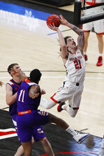 Texas Tech guard Avery Benson goes in for a dunk during the first half of the team's NCAA college basketball game against Northwestern State, Wednesday Nov. 25, 2020, in Lubbock, Texas. (AP Photo/Mark Rogers)