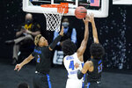 Creighton's Shereef Mitchell (4) shoots between UC Santa Barbara's Josh Pierre-Louis (2) and Ajare Sanni (13) during the first half of a college basketball game in the first round of the NCAA tournament at Lucas Oil Stadium in Indianapolis Saturday, March 20, 2021. (AP Photo/Mark Humphrey)