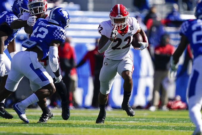 Georgia running back Kendall Milton (22) runs with the ball during the first half of an NCAA college football game against Kentucky, Oct. 31, 2020, in Lexington, Ky. (AP Photo/Bryan Woolston)