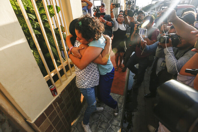 Opposition member María Adilia Peralta Cerratos is embraced by a relative as she returns home after being in prison, in Masaya, Nicaragua, Monday, May 20, 2019. Peralta Cerratos is one of 100 prisoners the Nicaraguan government released Monday in a form of house arrest, including three human rights activists. (AP Photo/Alfredo Zuniga)