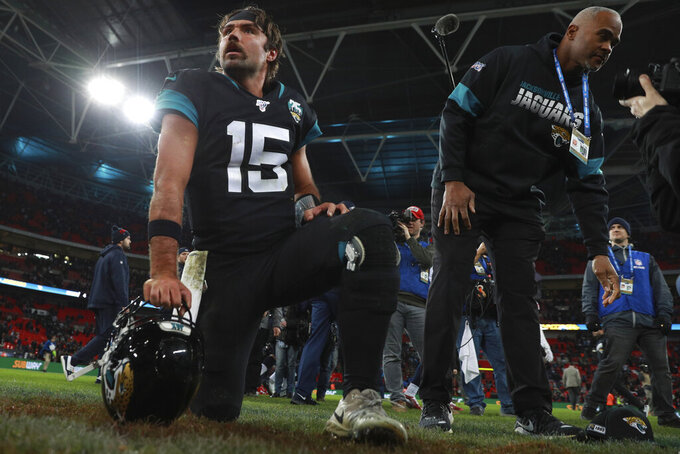 Jacksonville Jaguars quarterback Gardner Minshew kneels on the field after an NFL football game against the Houston Texans, at Wembley Stadium, Sunday, Nov. 3, 2019, in London. The Houston Texans won 26-3. (AP Photo/Ian Walton)