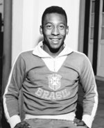 FILE - In this May 25, 1962 file photo, Brazil's Pele wears his national team's jersey in Rio de Janeiro, Brazil. On Oct. 23, 2020, the three-time World Cup winner Pele turns 80 without a proper celebration amid the COVID-19 pandemic as he quarantines in his mansion in the beachfront city of Guarujá, where he has lived since the start of the pandemic. (AP Photo, File)