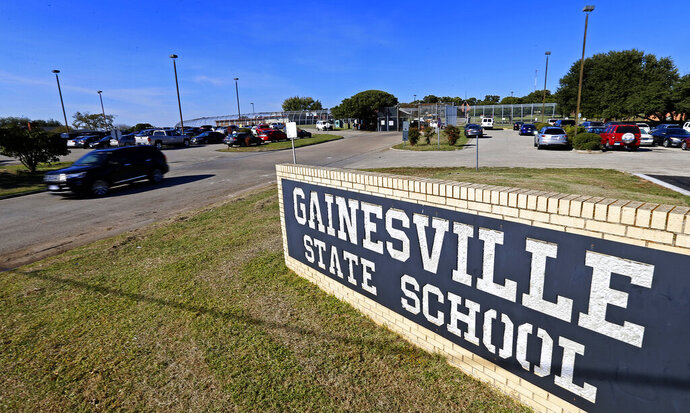 FILE - This Oct. 28, 2016, file photo, shows the Gainesville State School for juveniles in Gainesville, Texas. Detainees in Texas' juvenile prisons suffer from frequent physical and sexual abuse, inadequate mental healthcare and high rates of staff turnover, two youth advocacy groups wrote in a federal complaint Wednesday, Oct. 21, 2020. The rights of the hundreds of youths detained in five secure facilities around the state continue to be violated, despite recent and long-standing efforts at reform, according to Texas Appleseed and Disability Rights Texas. (Jae S. Lee/The Dallas Morning News via AP, File)
